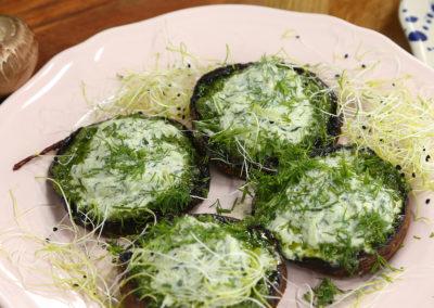Grilled portobello mushrooms with parsley pesto and tzatziki sauce